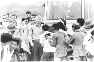 Photograph: McCain waiting for the rest of the group to leave the bus at airport after being released as POW Record Group 428 General Records of the Department of the Navy, 1947-2004 Citation: 428-GX Box 262 N 11556665 Rediscovery #10473 10473_2007_001